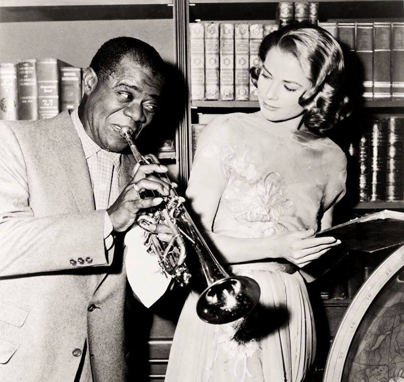 Grace Kelly & Louis Armstrong on the set of