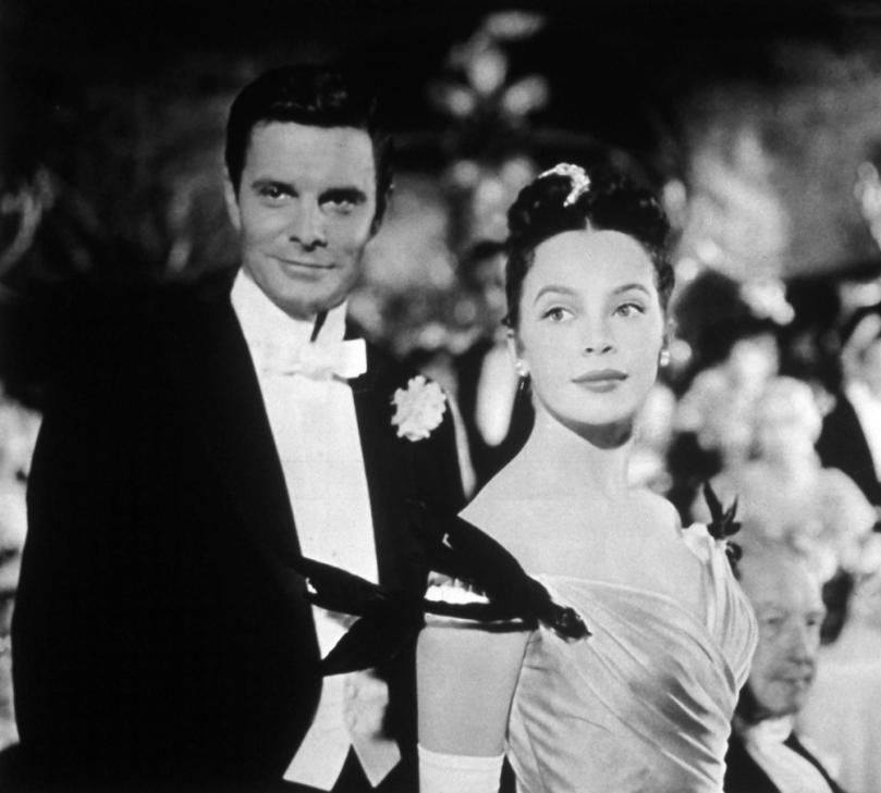 Louis Jourdan e Leslie Caron