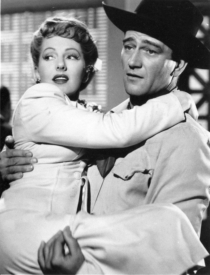 John Wayne e Jean Arthur