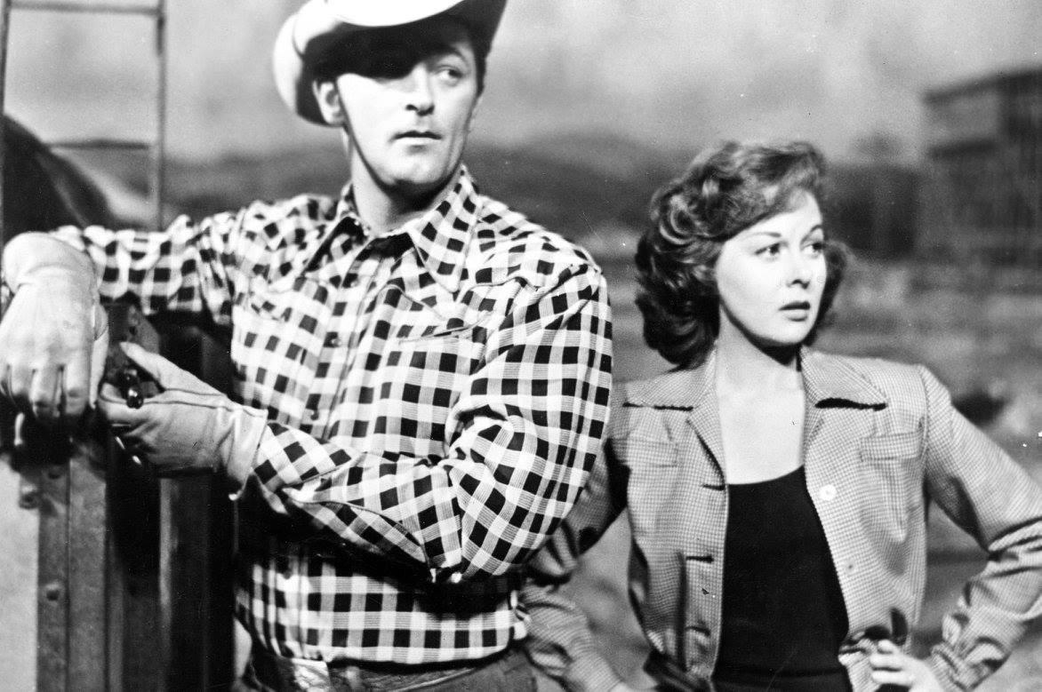 Robert Mitchum e Susan Hayward