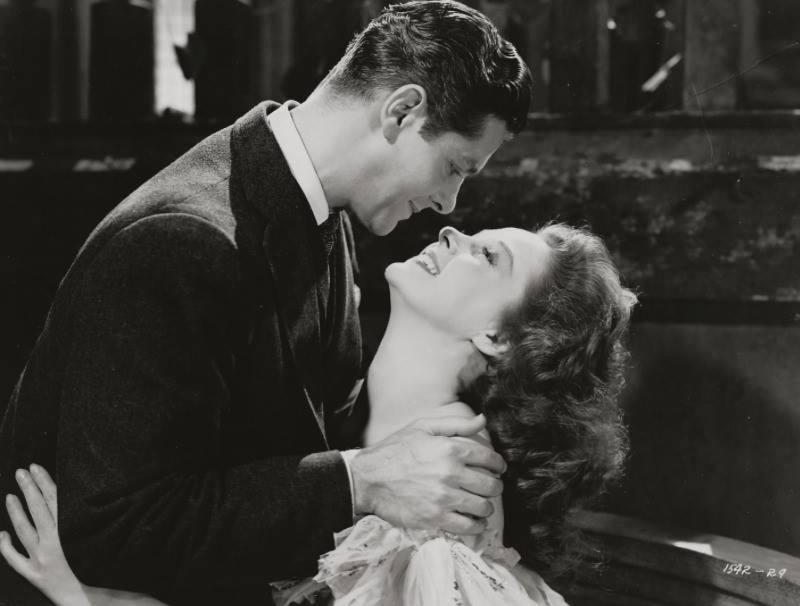 Robert Cummings e Susan Hayward