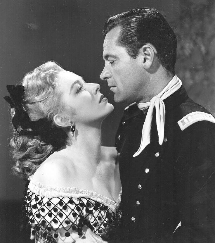 William Holden and Eleanor Parker