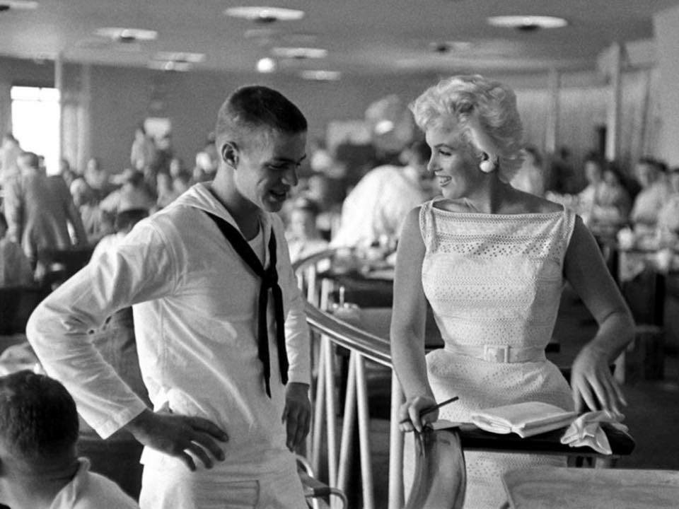 Marilyn Monroe greets a young sailor in Chicago, 1955