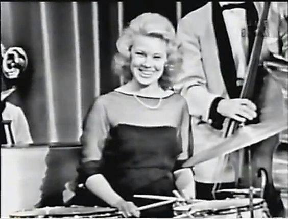 Betsy Palmer playing drums on