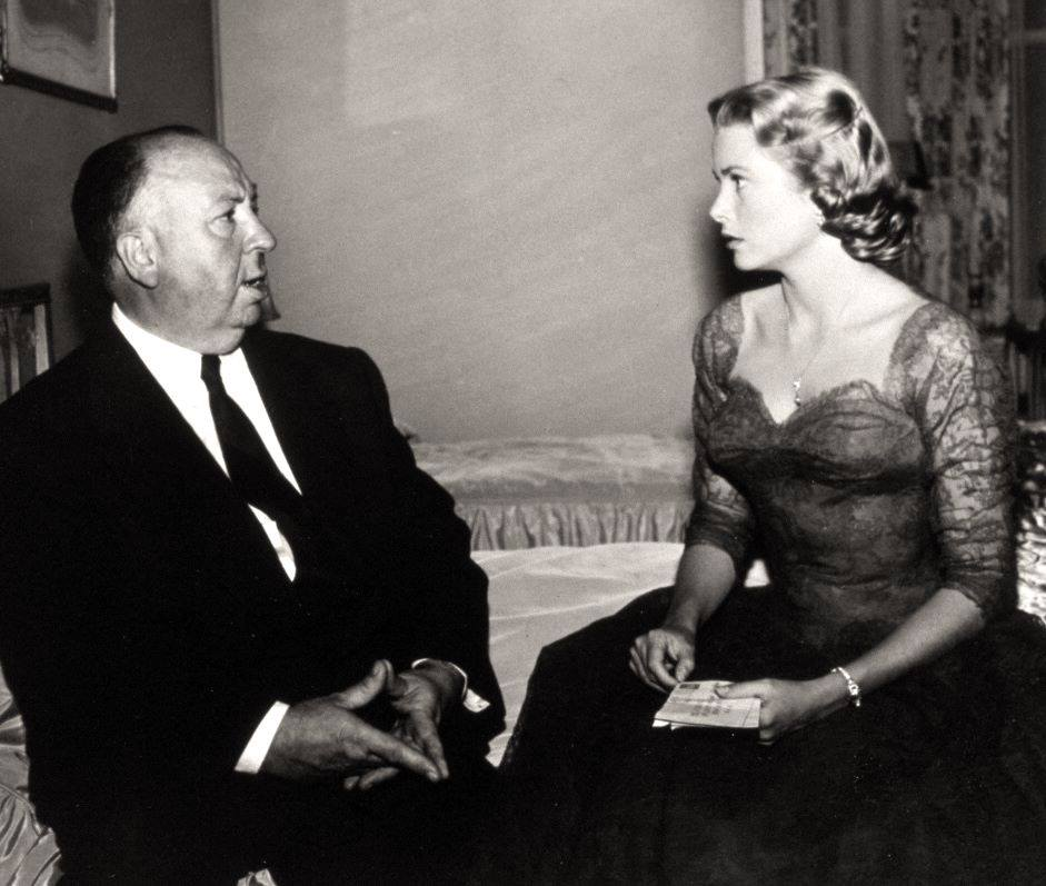 Grace Kelly with Alfred Hitchcock on the set of