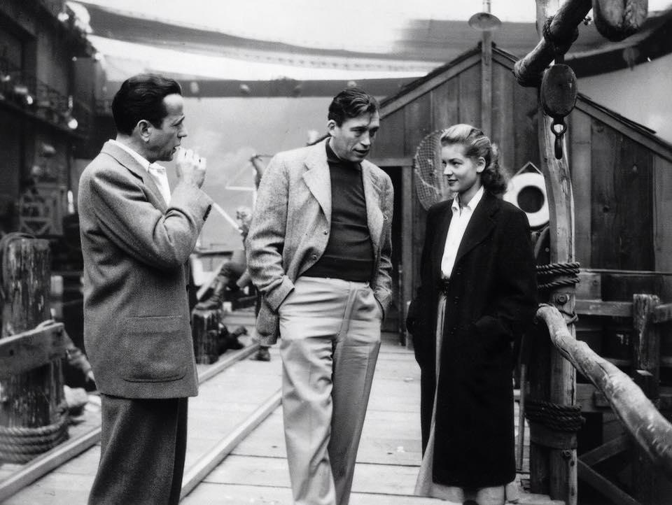 Humphrey Bogart & Lauren Bacall & John Huston on set of