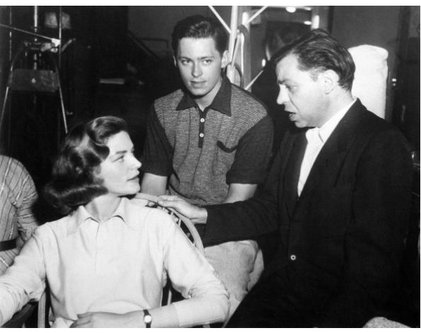 Lauren Bacall, John Kerr and Oscar Levant on the set of