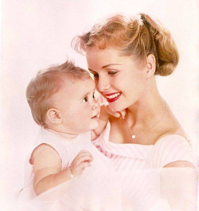 DEBBIE REYNOLDS and her daughter Carrie in 1957