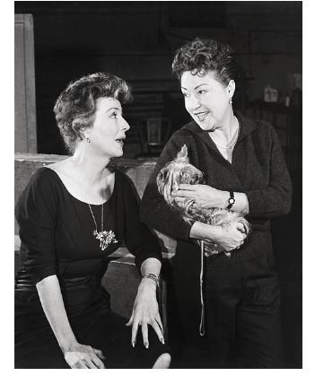 Gypsy Rose Lee and Ethel Merman during a rehersal break of 'Gypsy' a musical based on the memoirs of Gypsy Rose Lee in which Ethel Merman starred.