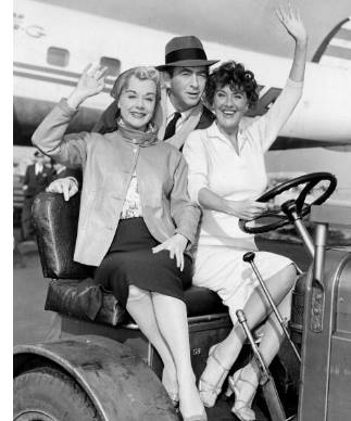 June Havoc (left) and her sister, Gypsy Rose Lee, with MacDonald Carey at Idlewild Airport after arriving from the West Coast. October 08, 1958