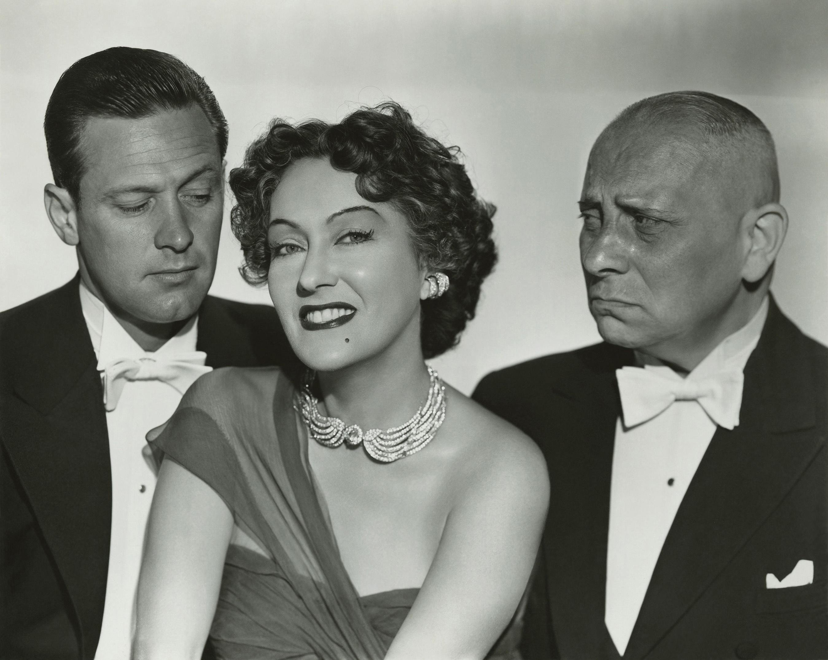 (L to R) William Holden, Gloria Swanson, Erich von Stroheim