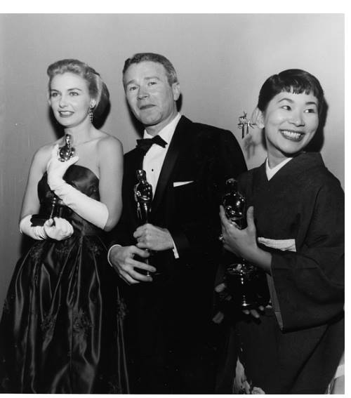 Joanne Woodward, Red Buttons and Miyoshi Umeki holding their Oscars, at the 30th Academy Awards, Los Angeles, March 26th 1958.