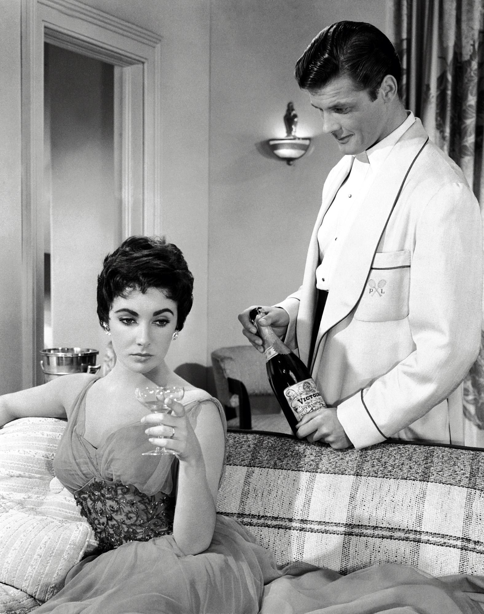 Elizabeth Taylor With Roger Moore.