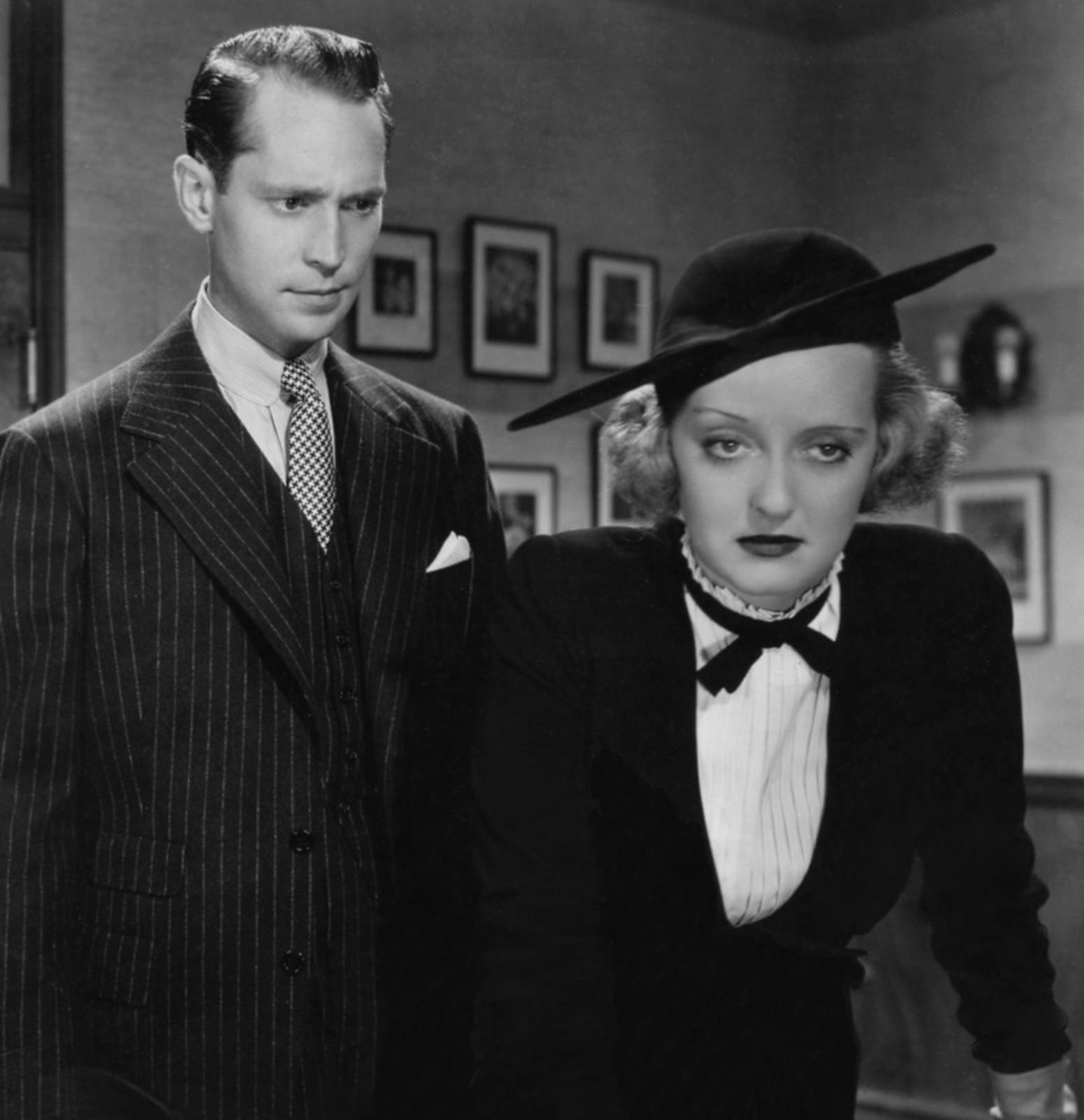 Franchot Tone with Bette Davis.