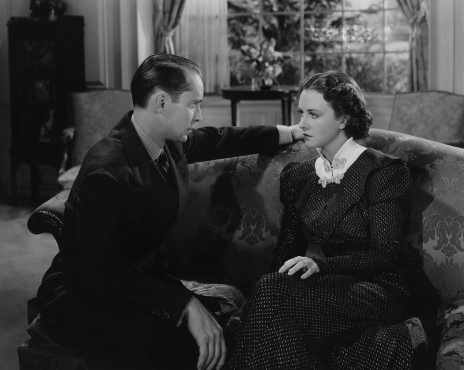 Franchot Tone with Margaret Lindsay.