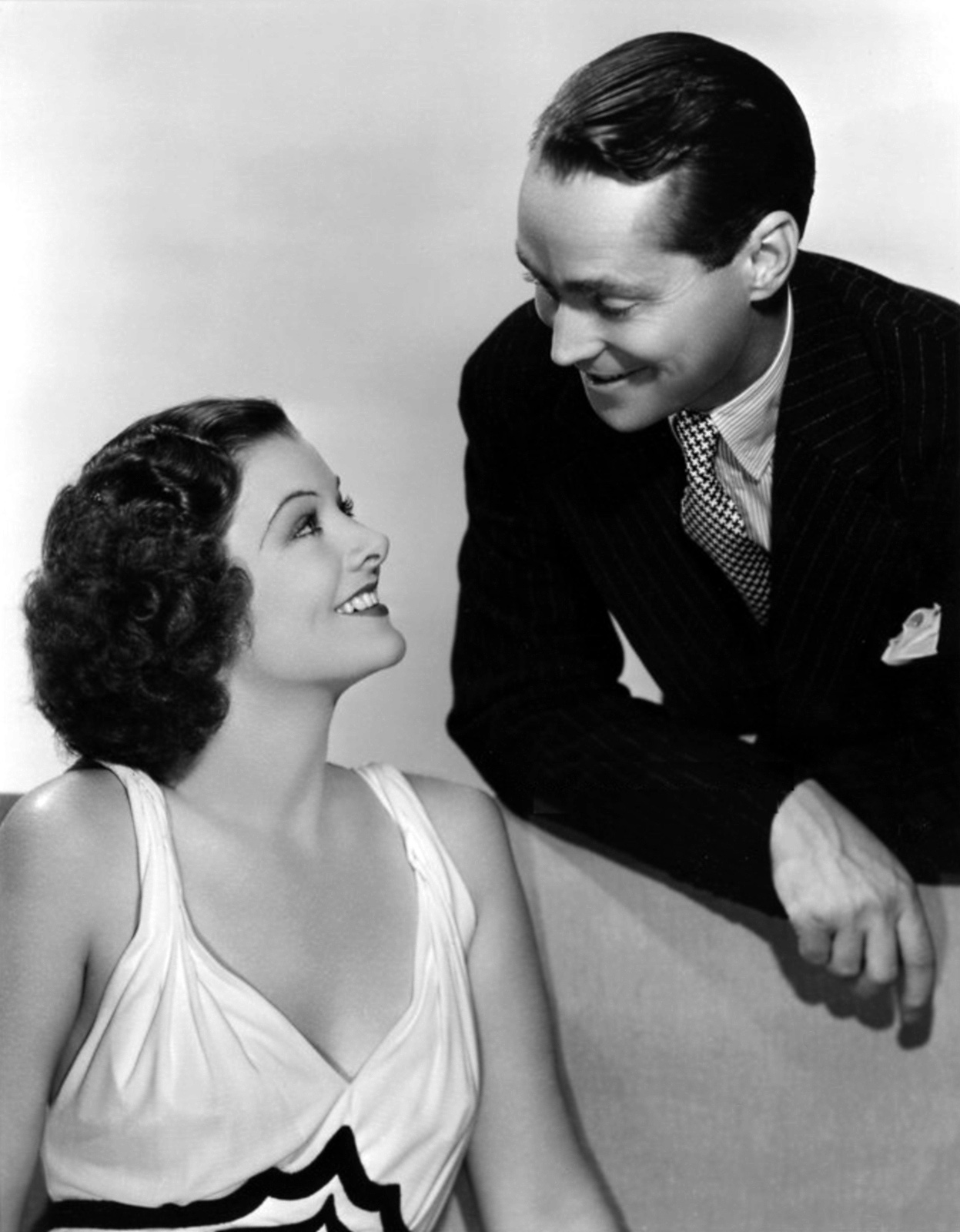 Franchot Tone with Myrna Loy.