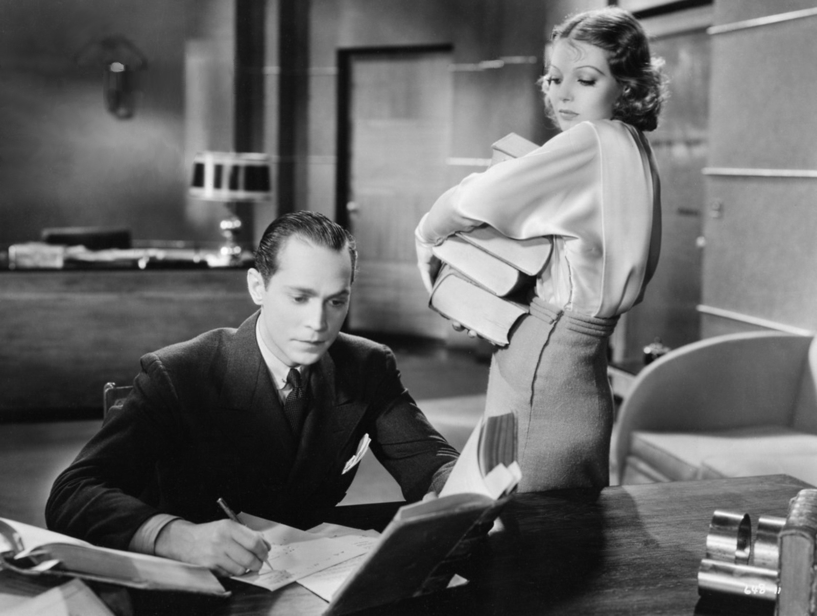 Franchot Tone with Loretta Young.