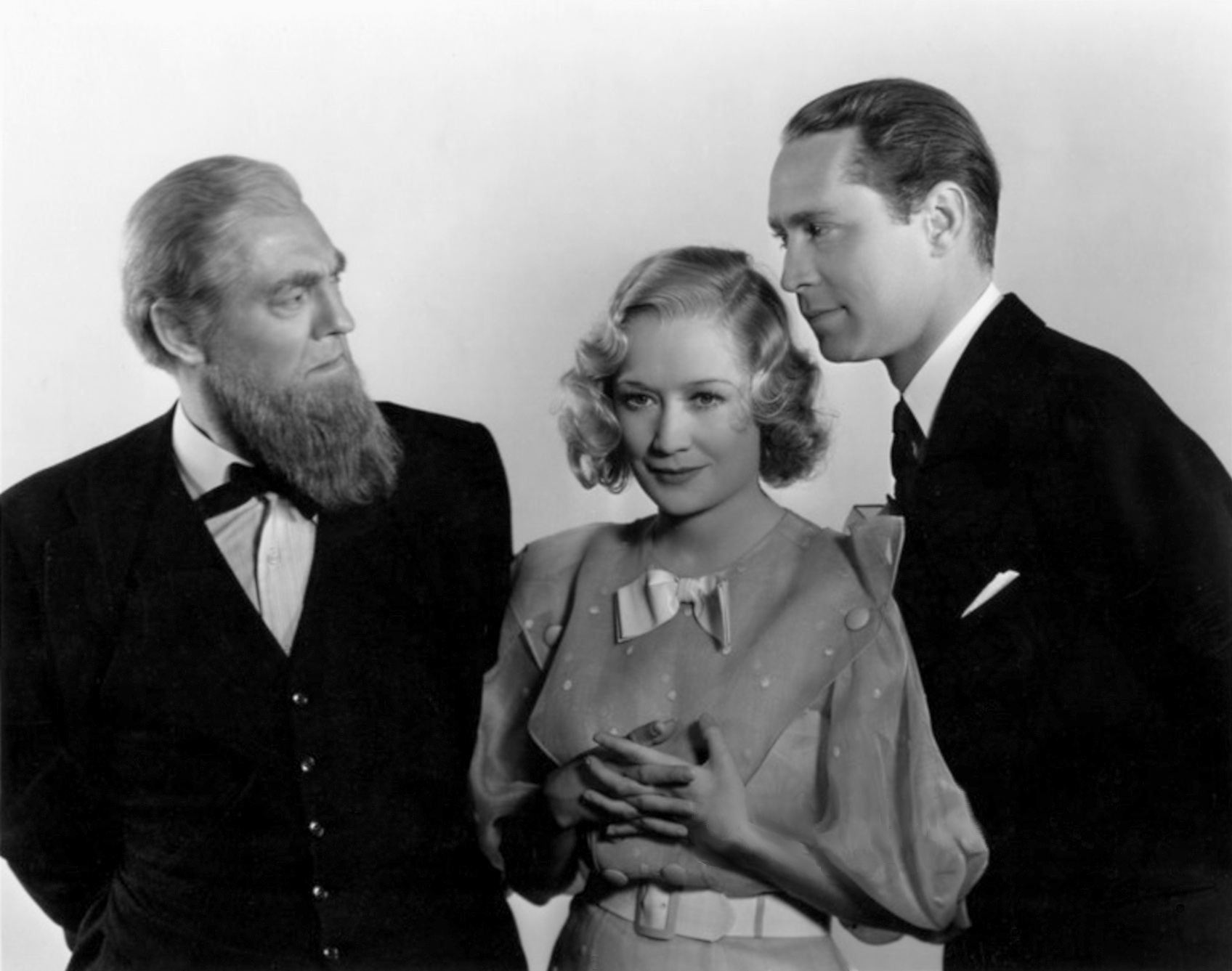 (L to R) Lionel Barrymore, Miriam Hopkins, Franchot Tone