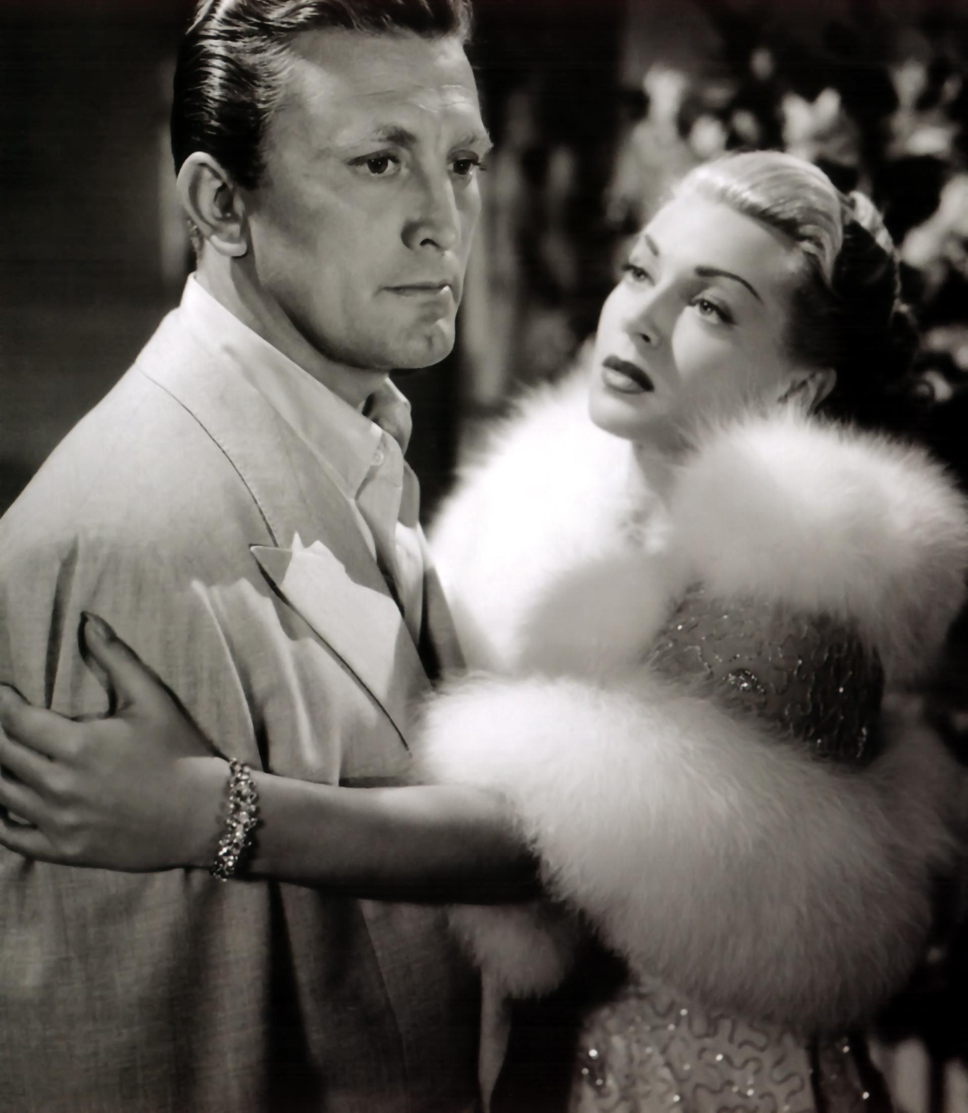 Lana Turner with  Kirk Douglas.
