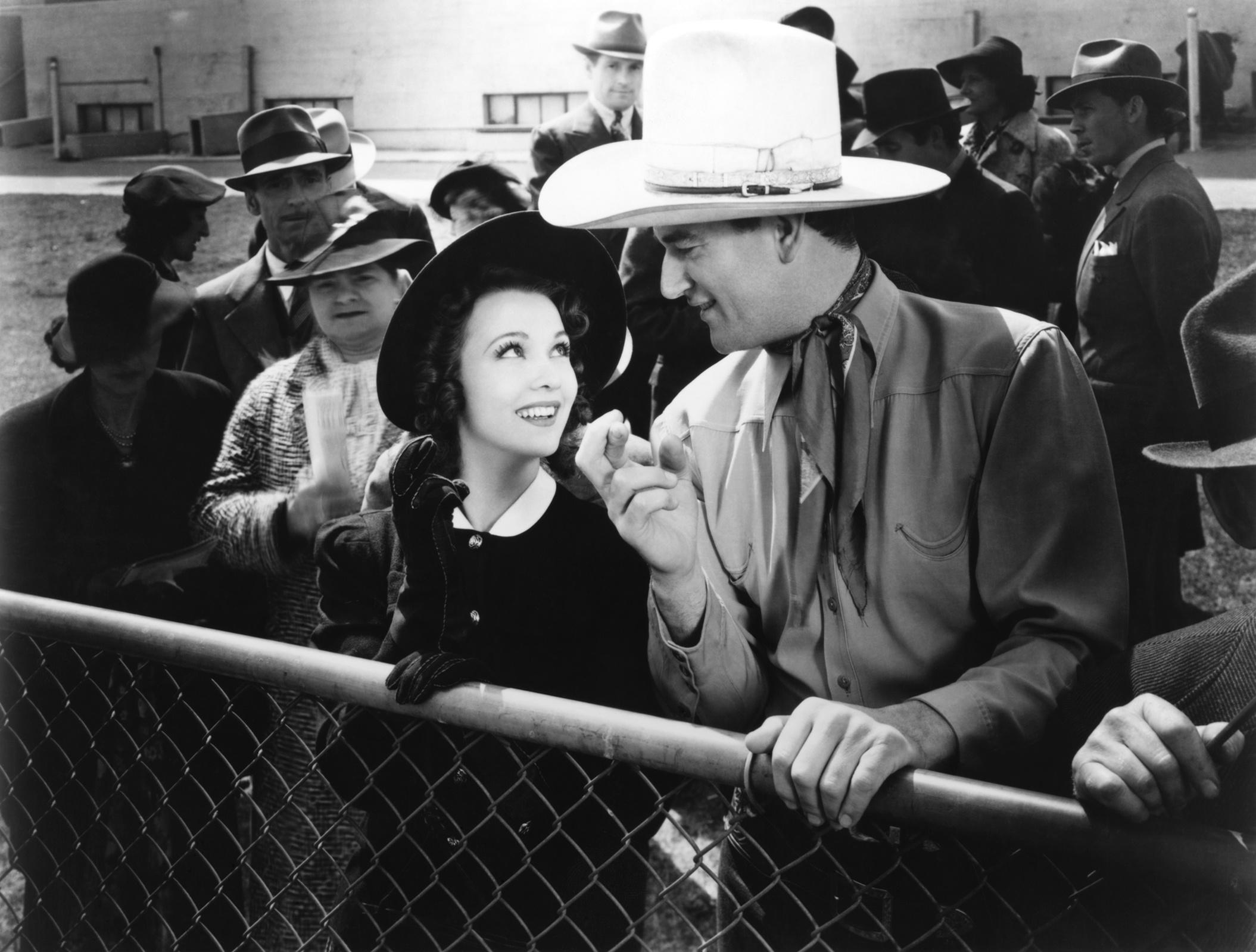 John Wayne with  Carole Landis.