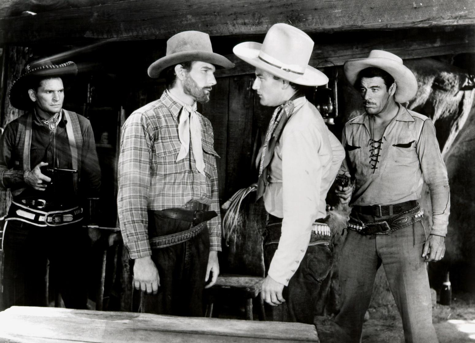(L to R) Yakima Canutt, Unknown, John Wayne, Glenn Strange