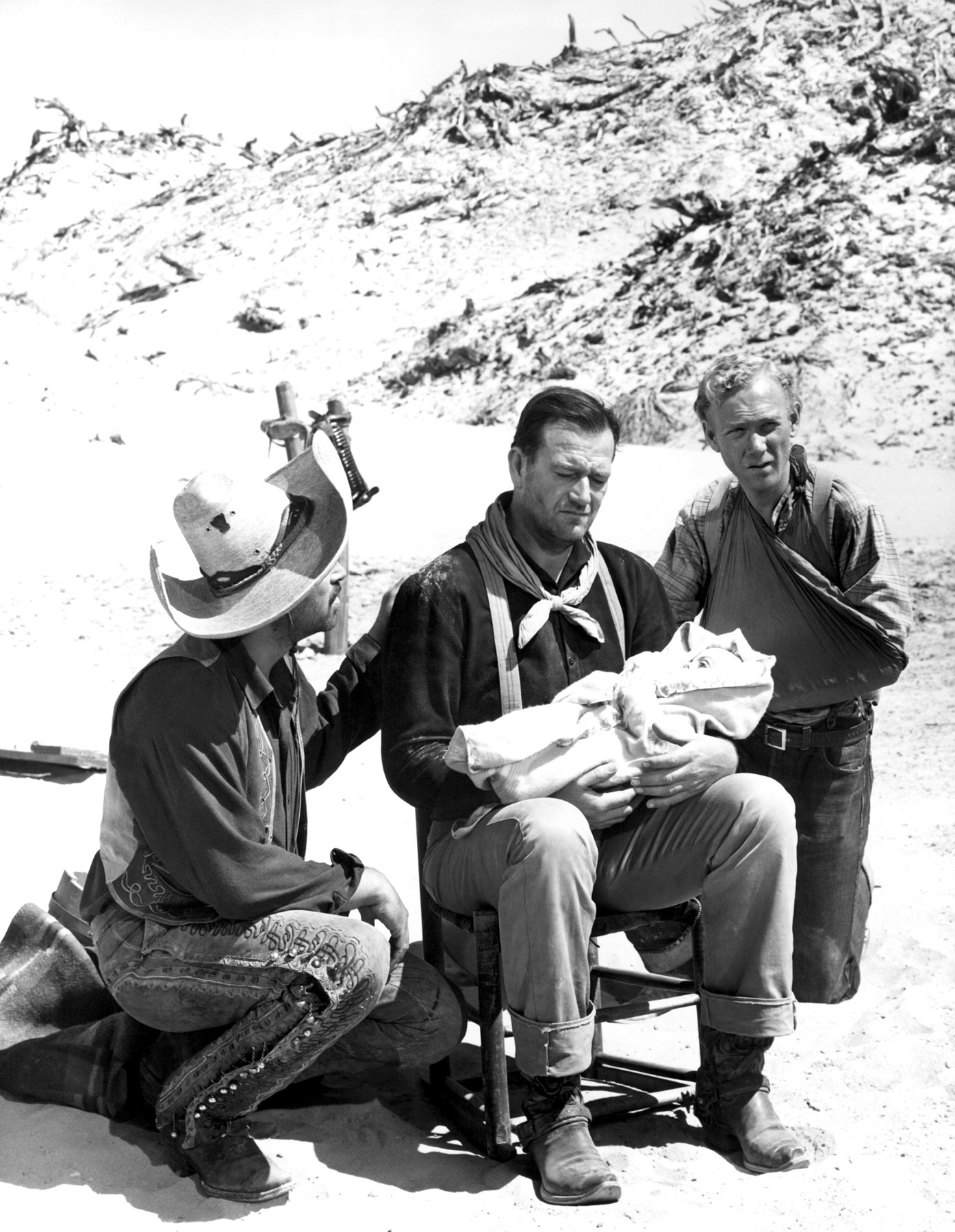 (L to R)  Pedro Armendáriz, John Wayne, Harry Carry, Jr