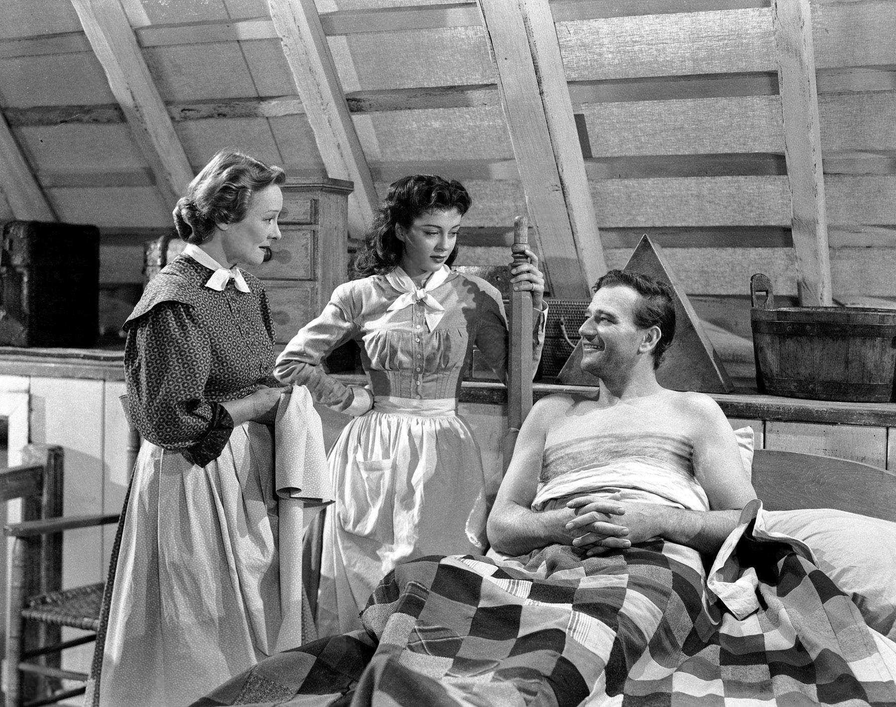 (L to R) Irene Rich, Gail Russell, John Wayne