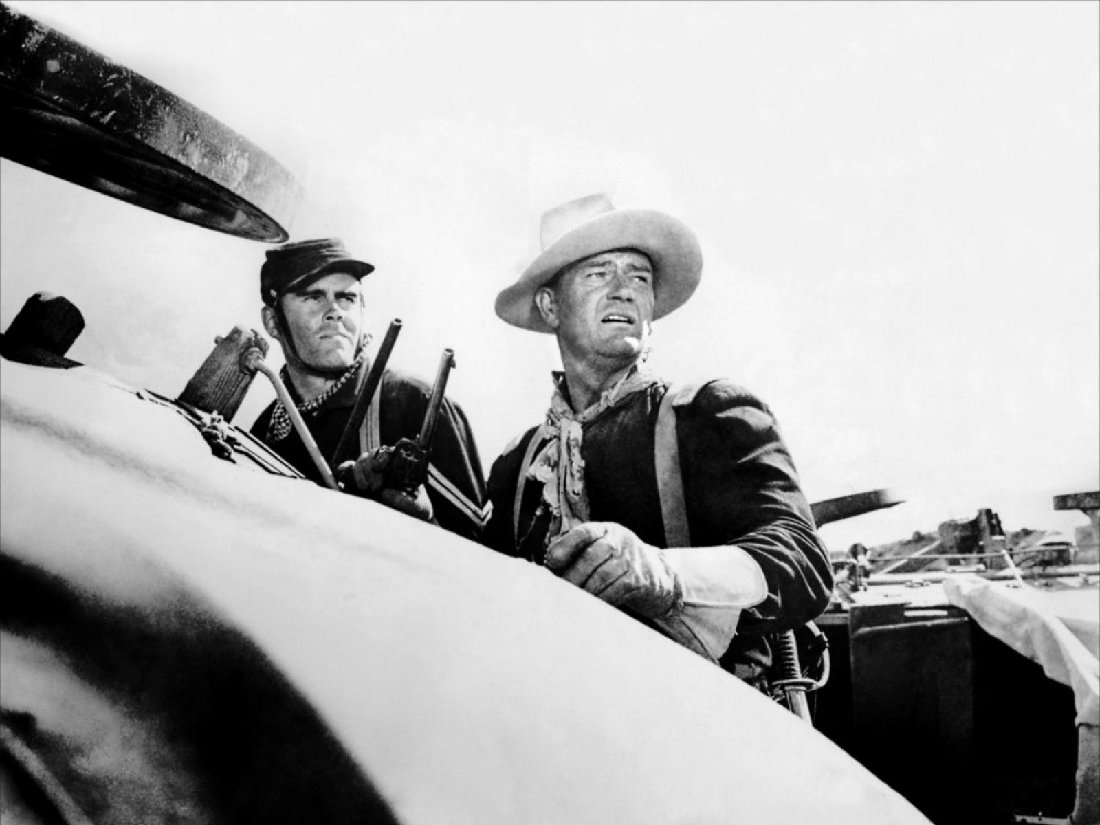 John Wayne with  Ray Hyke (L).