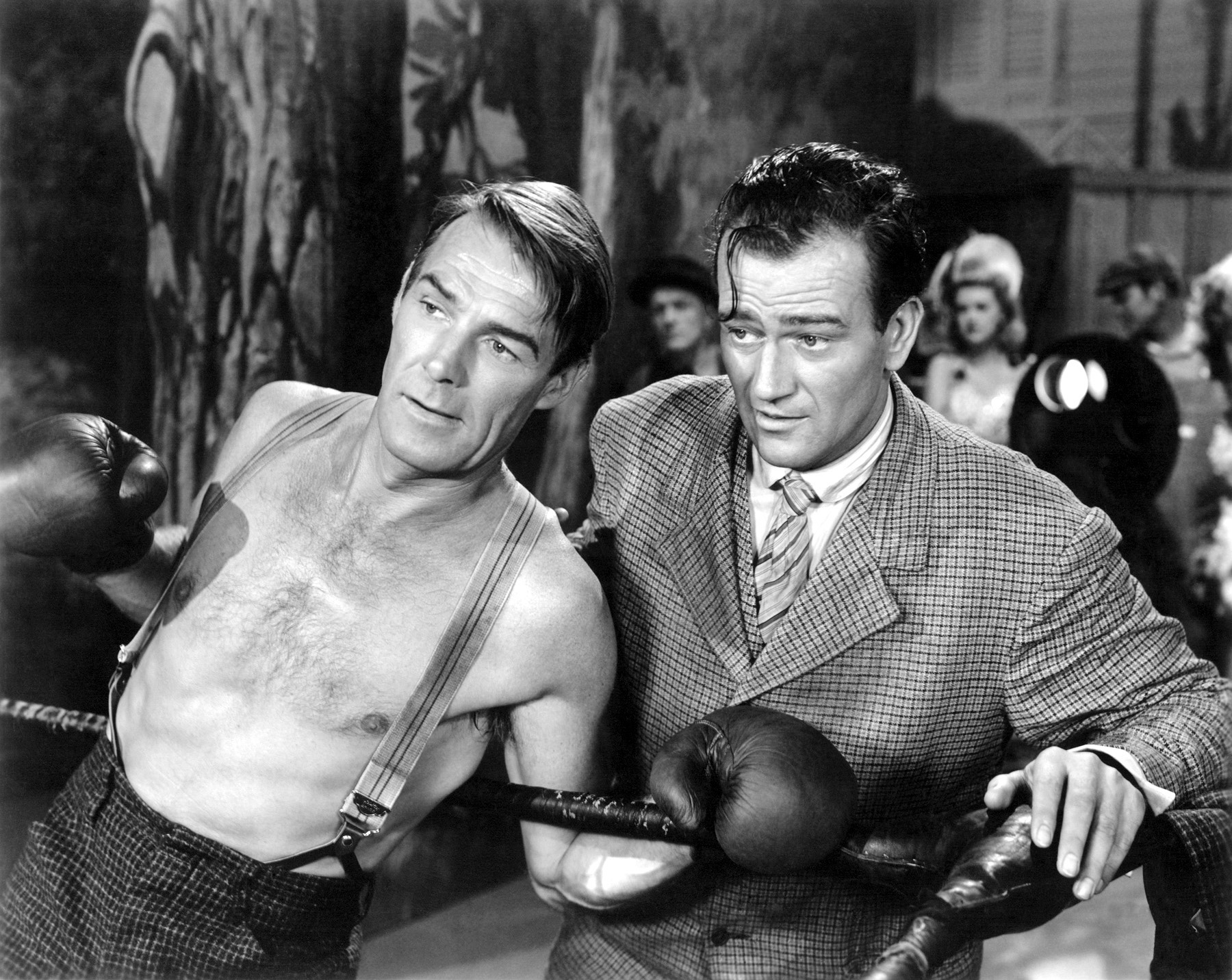John Wayne with Randolph Scott (L)