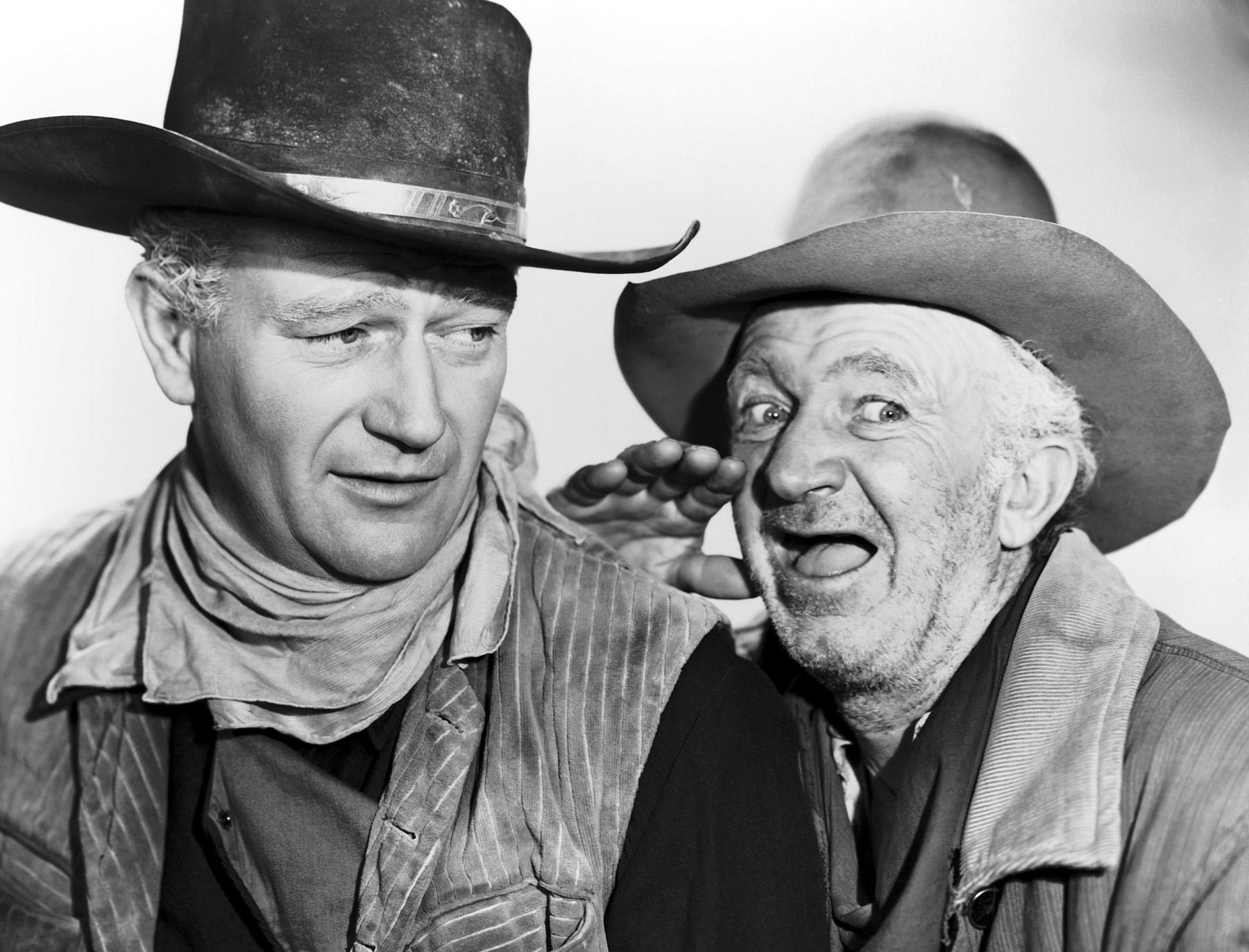 John Wayne with  Walter Brennan