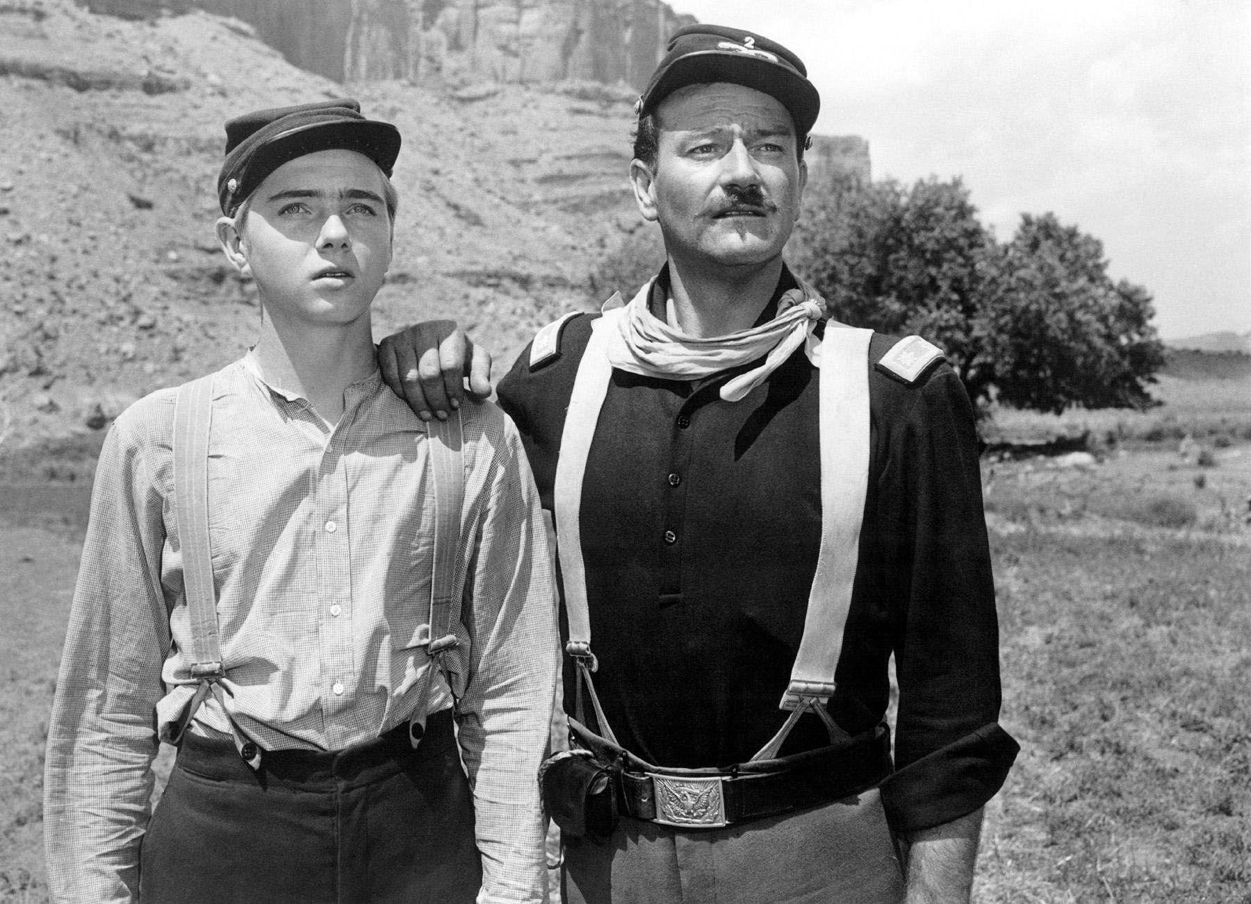 John Wayne with  Claude Jarman, Jr.