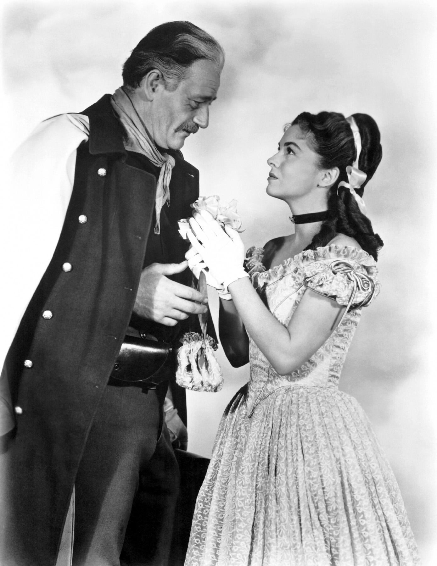 John Wayne with Joanne Dru.