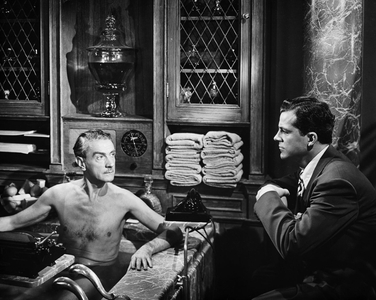 Clifton Webb with  Dana Andrews (R)