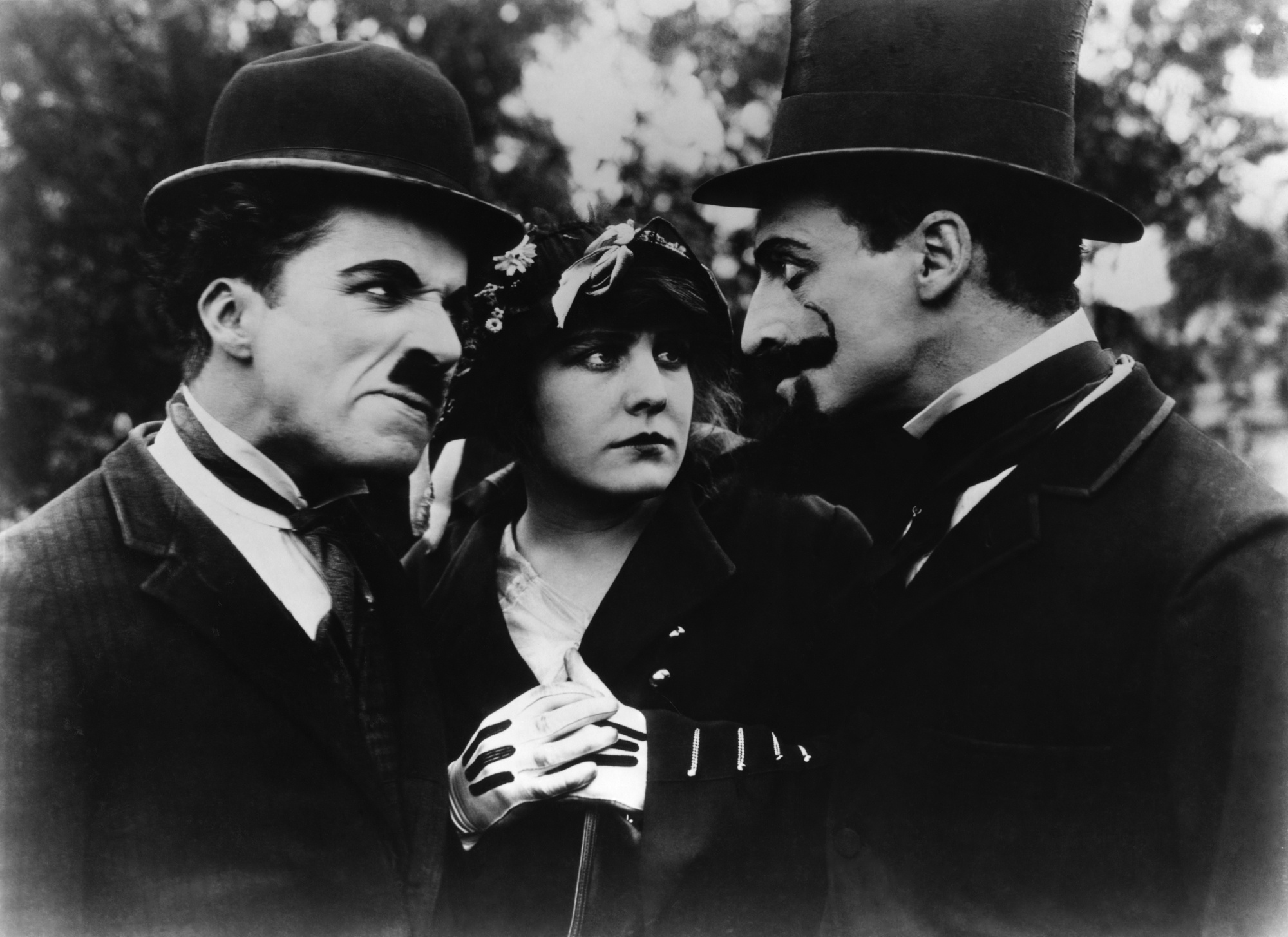 Charlie Chaplin with Edna Purviance and Leo White
