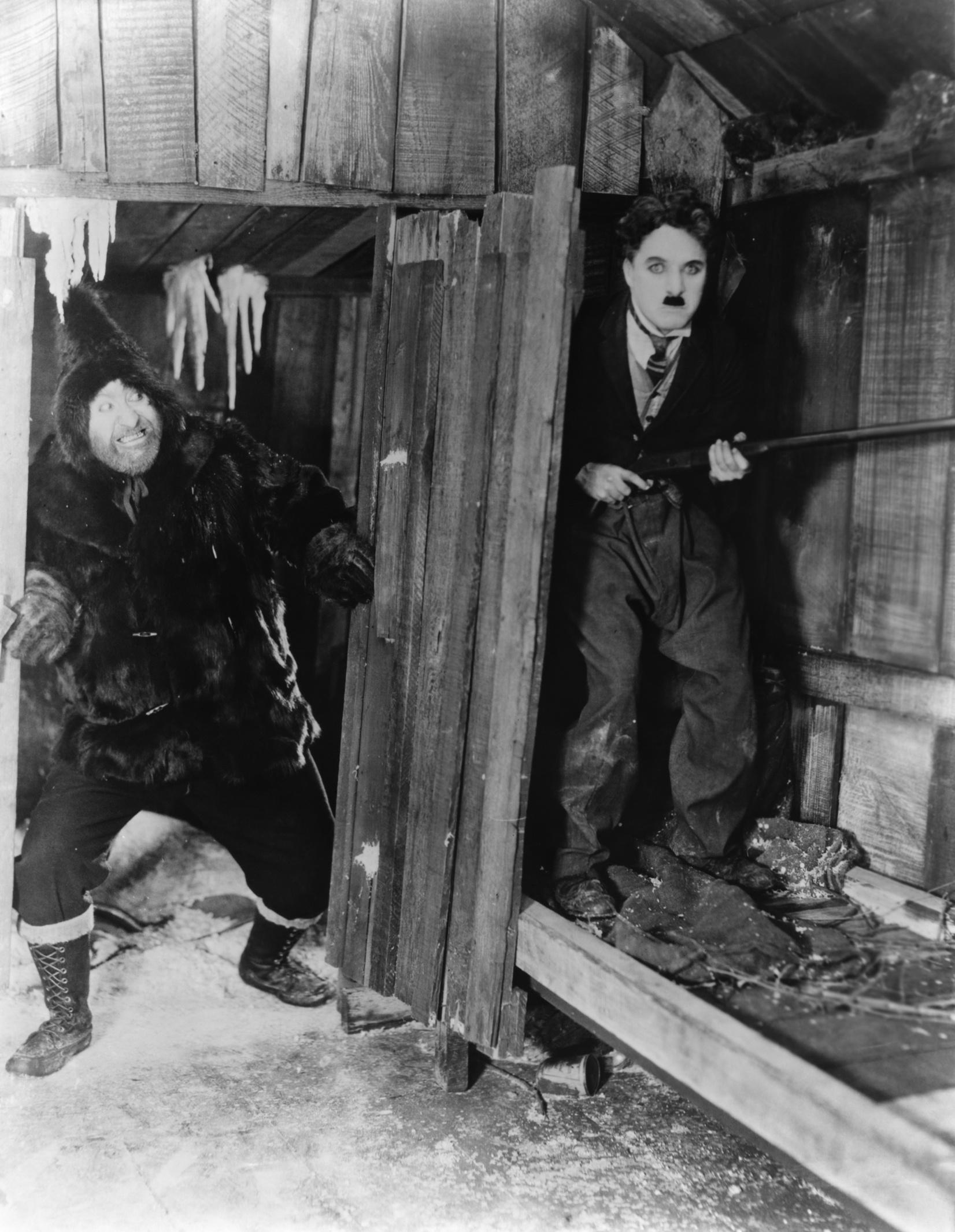 Charlie Chaplin with Mack Swain (R)