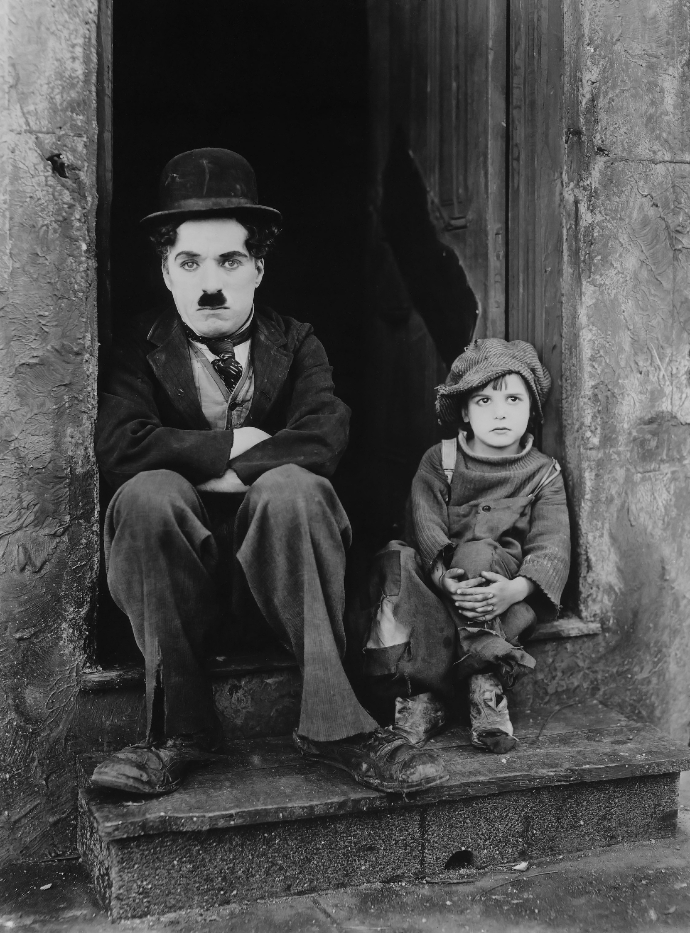 Charlie Chaplin with Jackie Coogan (R)