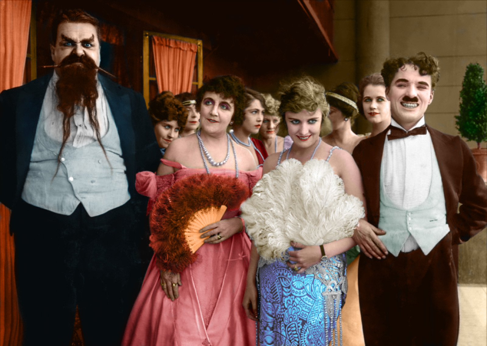 (L to R) Eric Campbell,Marta Golden,Edna Purviance and Charlie Chaplin