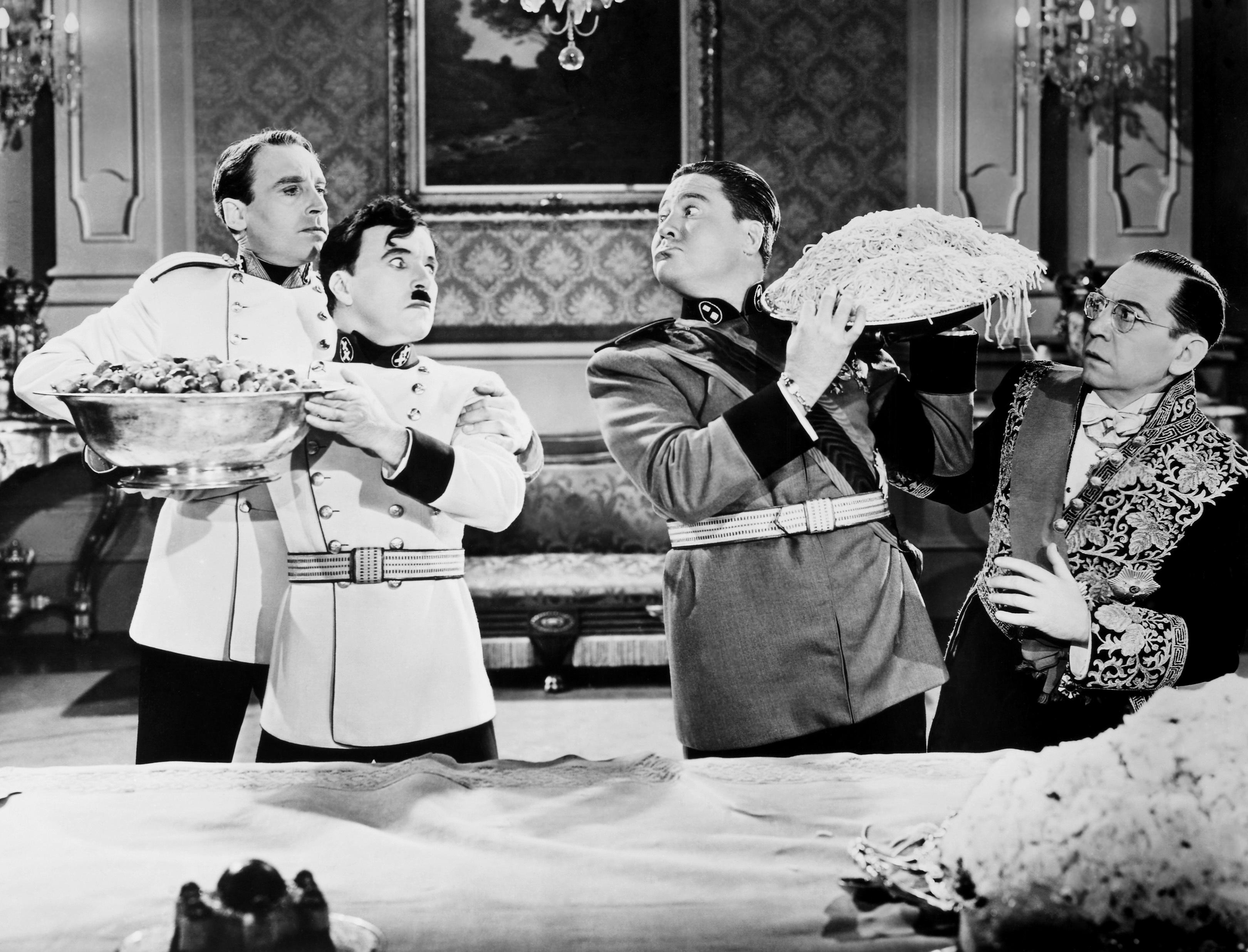(L to R) Henry Daniell, Charlie Chaplin, Jack Oakie,Carter DeHaven
