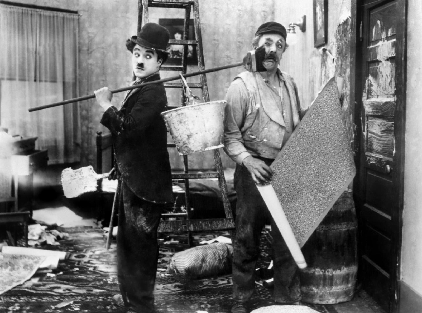 Charlie Chaplin with Bud Jamison (R)