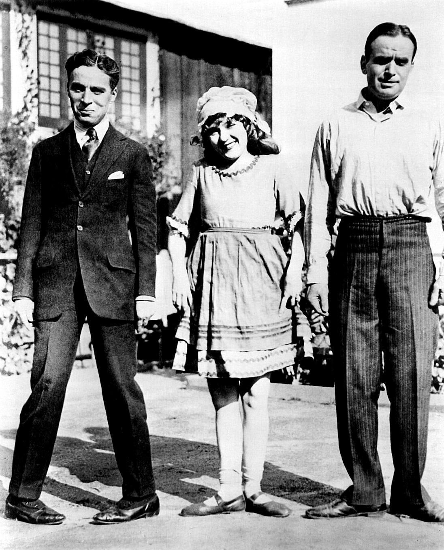 (L to R) Charlie Chaplin, Mary Pickford,Douglas Fairbanks, Sr.
