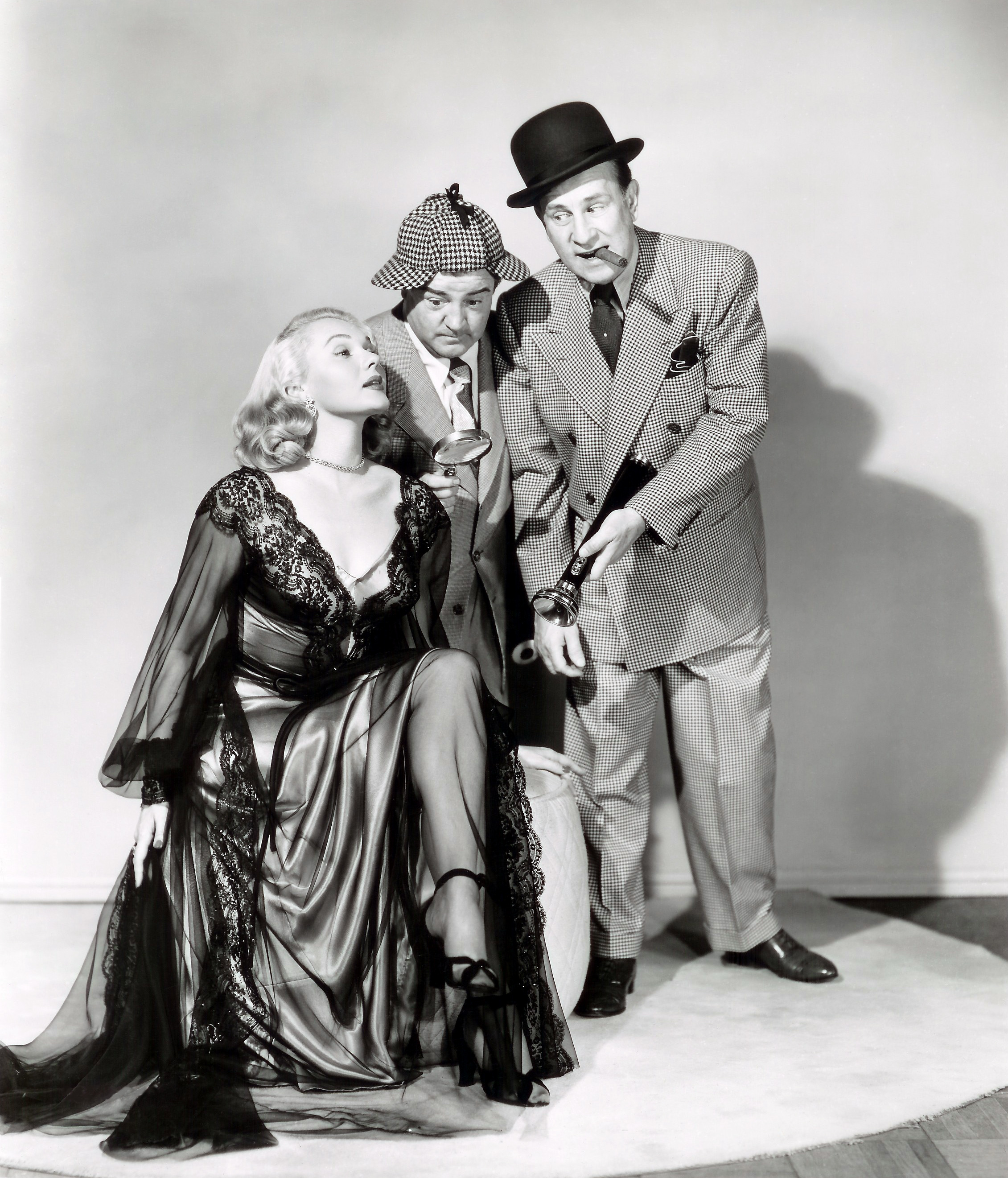 Adele Jergens with Lou Costello and Bud Abbott.
