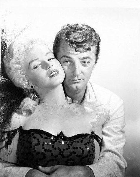 obert Mitchum e Marilyn Monroe