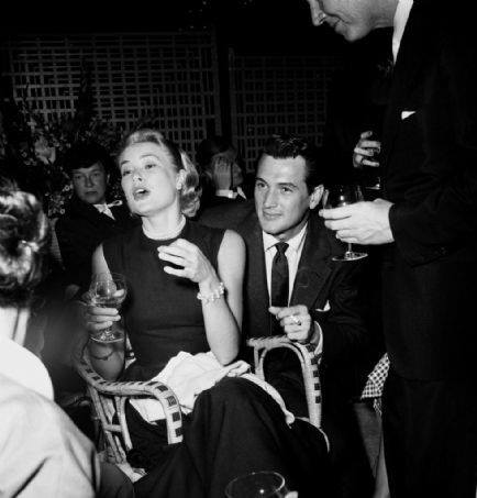Grace Kelly with Rock Hudson at a party