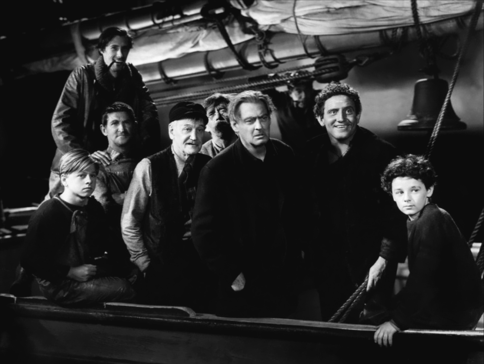 Spencer Tracy with Mickey Rooney , John Carradine (L),Lionel Barrymore (C) and Freddie Bartholomew