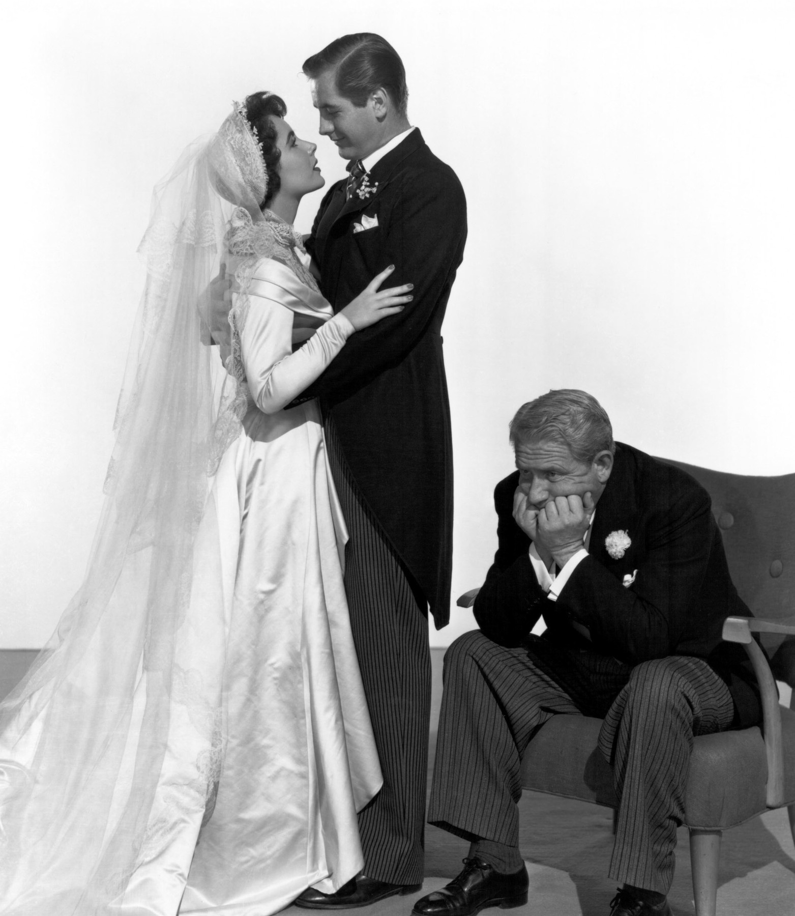 Spencer Tracy with Elizabeth Taylor and Don Taylor.