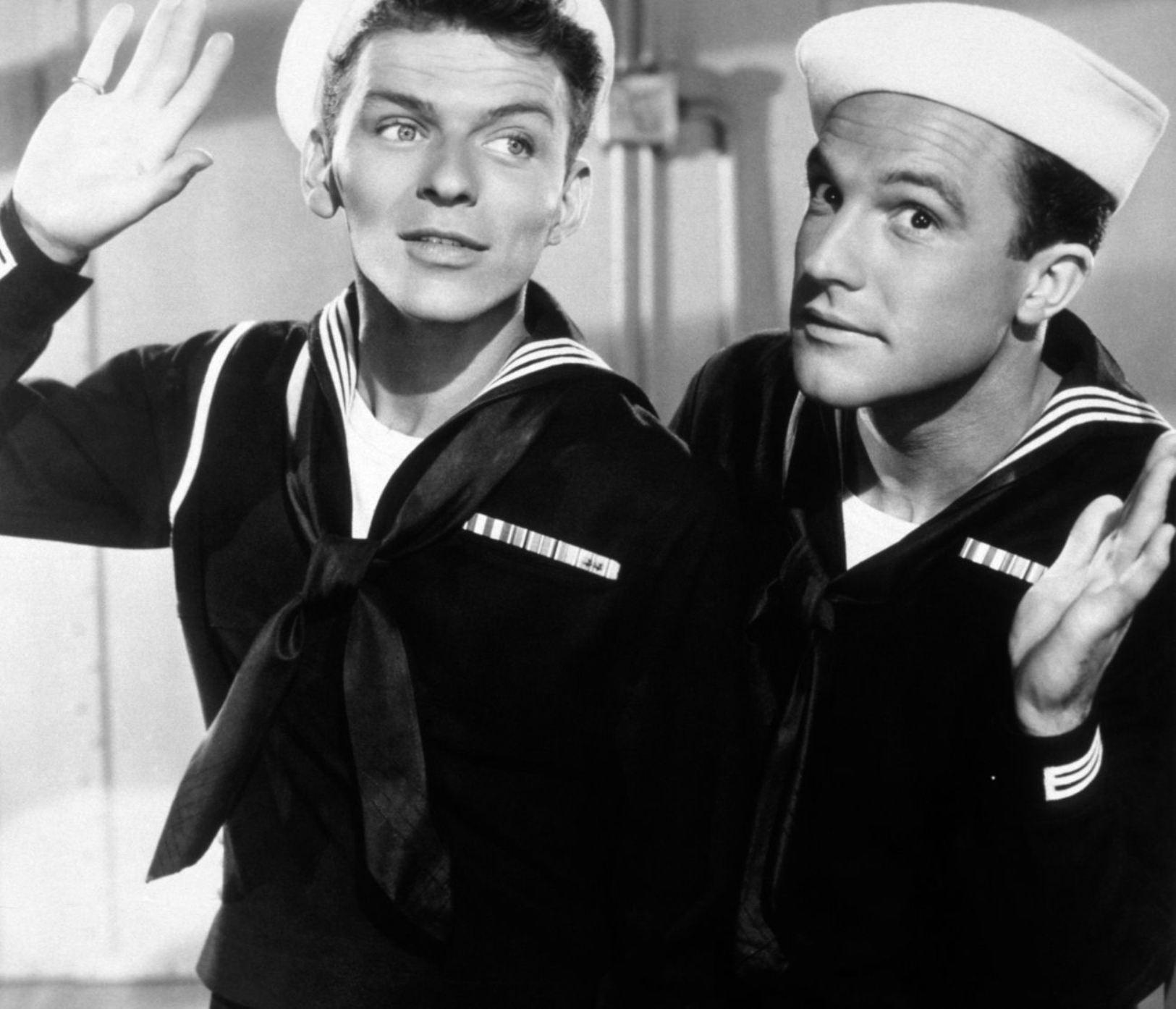 Gene Kelly with Frank Sinatra (L)