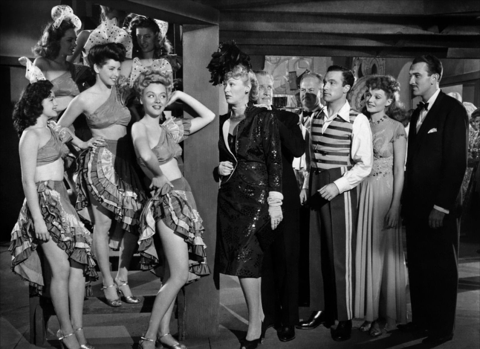 Gene Kelly with Eve Arden (C) and Rita Hayworth/Lee Bowman (R)