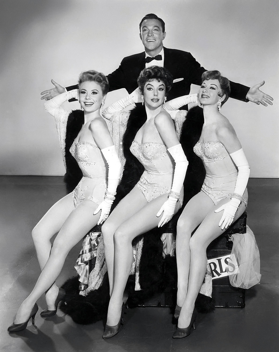 Gene Kelly with (L to R)Mitzi Gaynor,Kay Kendall,Taina Elg