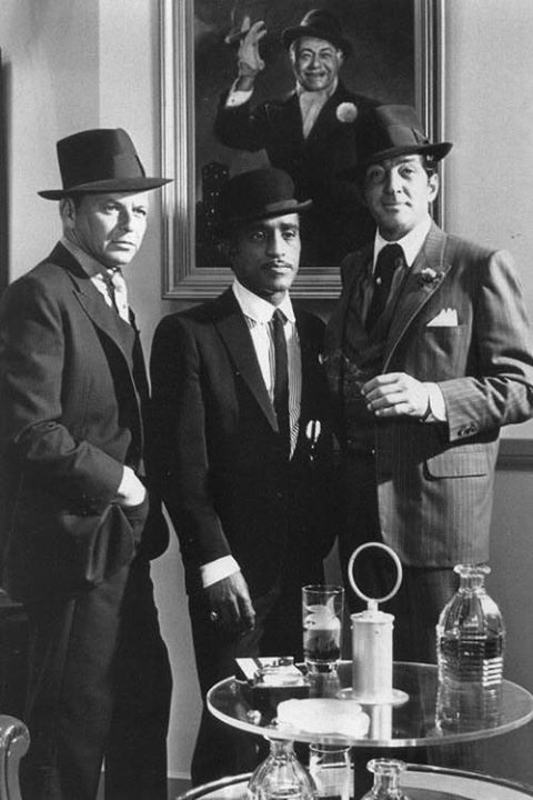 Frank Sinatra, Sammy Davis, Jr., and Dean Martin behind a portrait of Edward G. Robinson in the Rat Pack film Robin and the 7 Hoods (1964).