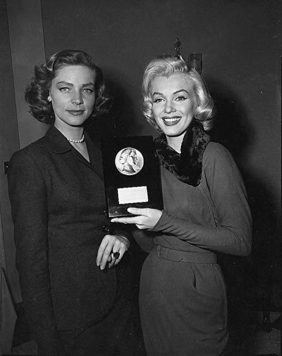 Lauren Bacall presents Marilyn Moroe with the LOOK Magazine achievement award 1952 as 'Most Promising Female Newcomer 1952', 15 March 1953